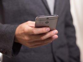Man holding cellphone