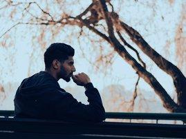 Man thinking on bench