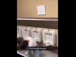 Two men fighting in the bathroom