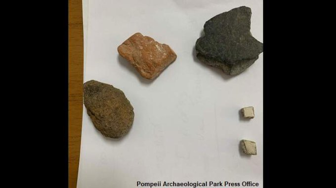 Woman returns stolen artefacts