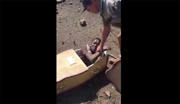 Black man forced into coffin by Afrikaners