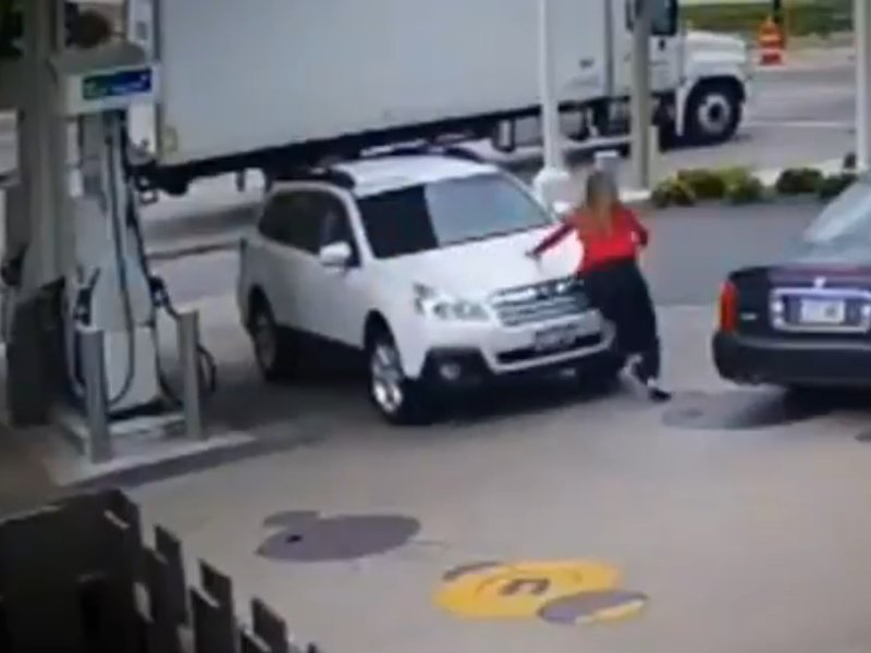 Woman jumps on car during hijacking