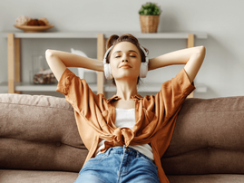 Woman listening to music on her couch