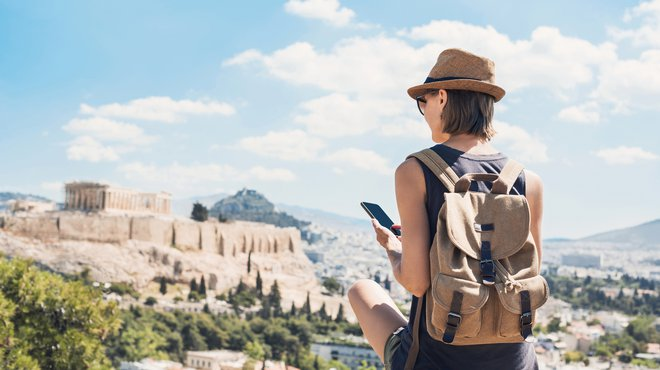 Woman using smart phone on vacation