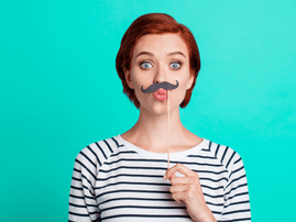 Woman with a fake moustache