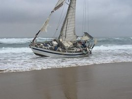Yacht washes up along South Broom beach