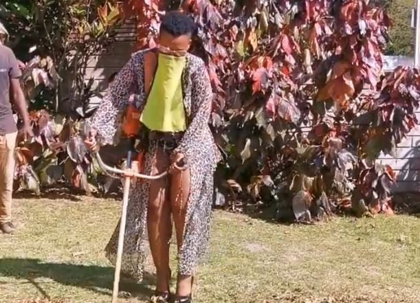 Zodwa Wabantu cutting the grass in heels